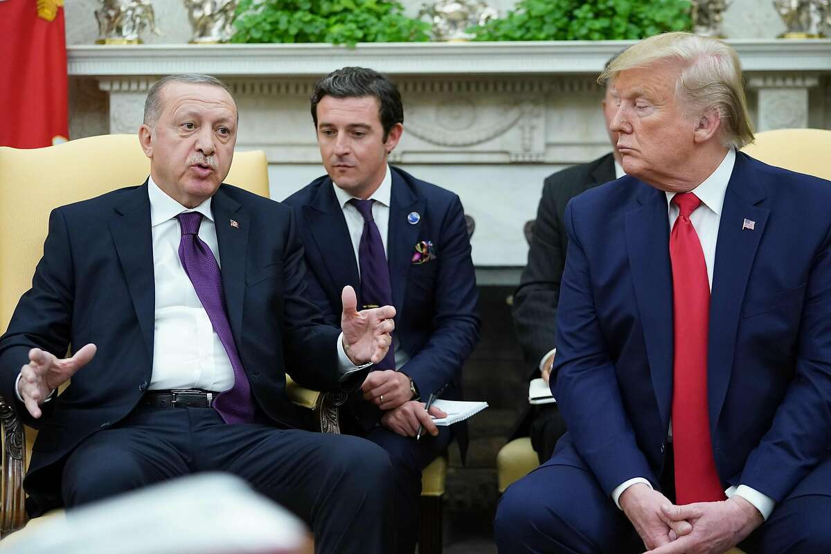 US President Donald Trump(R) and Turkey's President Recep Tayyip Erdo?an take part in a joint press conference in the East Room of the White House in Washington, DC on November 13, 2019. - President Donald Trump greeted his Turkish counterpart Recep Tayyip Erdogan at the White House for a high-stakes meeting Wednesday that underlined his claim to be ignoring the impeachment drama unfolding simultaneously in Congress. (Photo by MANDEL NGAN / AFP) (Photo by MANDEL NGAN/AFP via Getty Images)