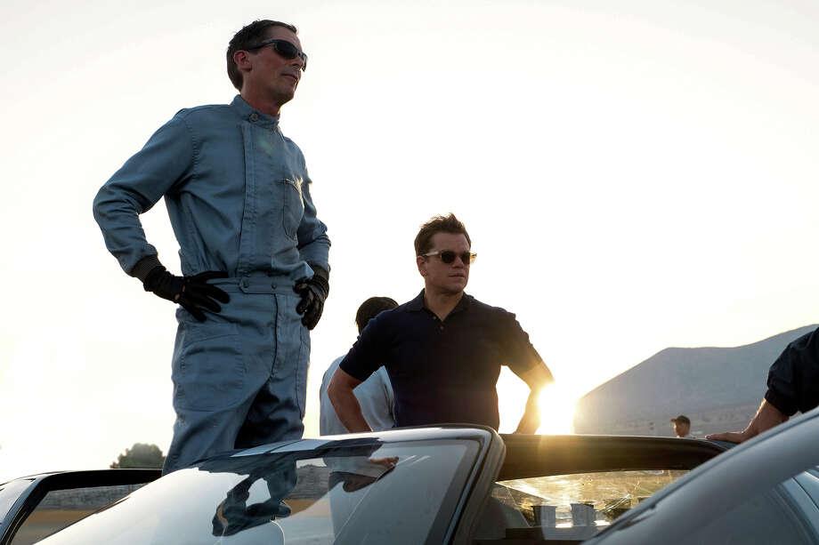 "Christian Bale, left, and Matt Damon star in ""Ford v Ferrari."" Photo: Merrick Morton/Twentieth Century Fox / © 2019 Twentieth Century Fox Film Corporation."