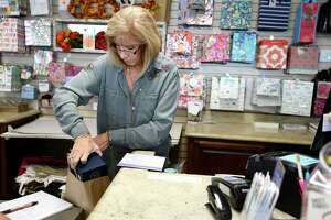 Tricia Shockley helps a customer at the Flagship Mail Room in Beaumont. The gift and shipping store hires seasonal workers to help as holiday shoppers browse for gifts and ship them to friends and family.  Photo taken Tuesday 9/18/18  Ryan Pelham/The Enterprise