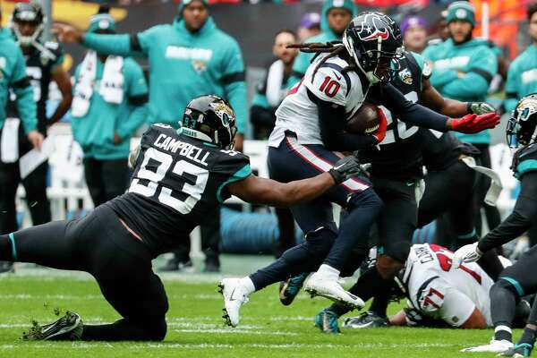 Houston Texans wide receiver DeAndre Hopkins (10) is hit by Jacksonville Jaguars defensive end Calais Campbell (93) after a reception during the first quarter of an NFL football game at Wembley Stadium on Sunday, Nov. 3, 2019, in London.