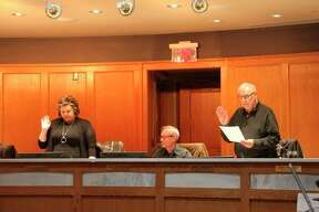 JermaineCipcic and James Grabowski take an oath on Tuesday as part of Manistee City Council's annual organizational meeting. (Ashlyn Korienek/News Advocate)