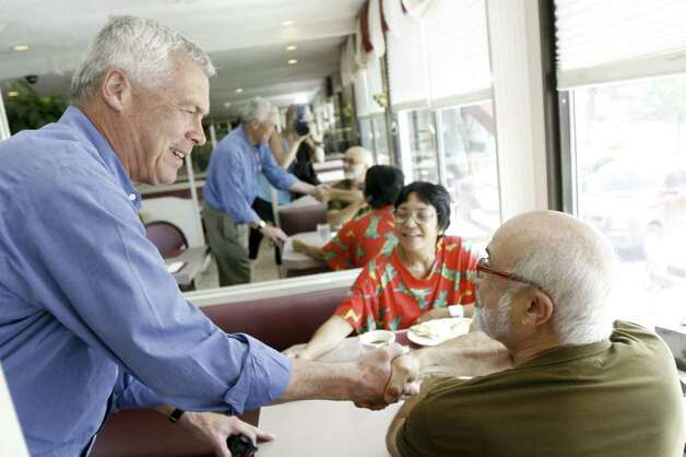 Republican gubernatorial candidate Oz Griebel shakes hands with Richard Freitas at Penny's Diner in Fairfield on Tuesday, August 10, 2010. Griebel visited various voting centers and establishments throughout the day to meet with voters. Photo: Laura Buckman / Connecticut Post Freelance