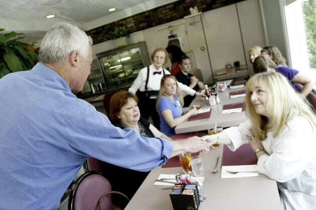 Susan Segall shakes hands with Republican gubernatorial candidate Oz Griebel at Penny's Diner in Fairfield on Tuesday, August 10, 2010. Griebel visited various voting centers and establishments throughout the day in order to meet with voters. Photo: Laura Buckman / Connecticut Post Freelance