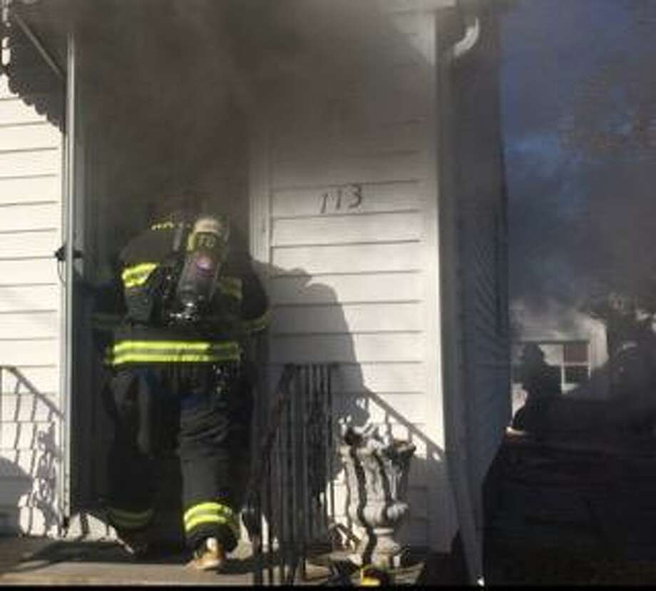 A family was displaced after a fire at their Hamden, Conn., home on Nov. 13, 2019. Photo: Contributed Photo / Hamden Fire Department