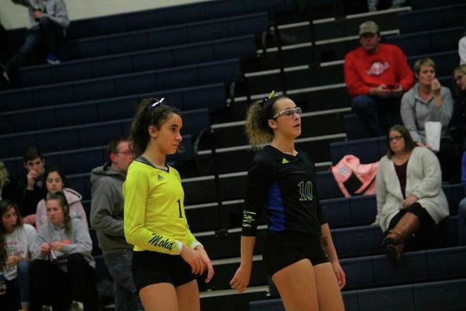 Breanna Berry (right) and her sister Braelyn get ready for action in Thursday's district title match. (Pioneer photo/John Raffel)