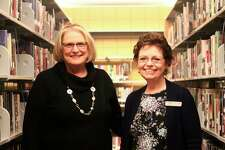 Mary Ann Lenon (left) and HollySwincicki(right) will be stepping down from their positions as director and assistant director on Dec. 31. Lenon has worked at the library for 41 years, and Swincicki has worked there for 27 years. (Pioneer photo/Catherine Sweeney)