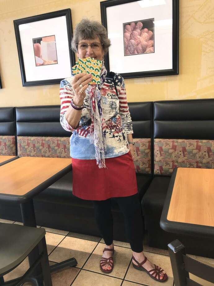 Christine Cummings, photographed in a Subway restaurant with the purchased gift cards during their cross-country trip in May from California to Connecticut. Photo: Contributed Photo / Subway Restaurant
