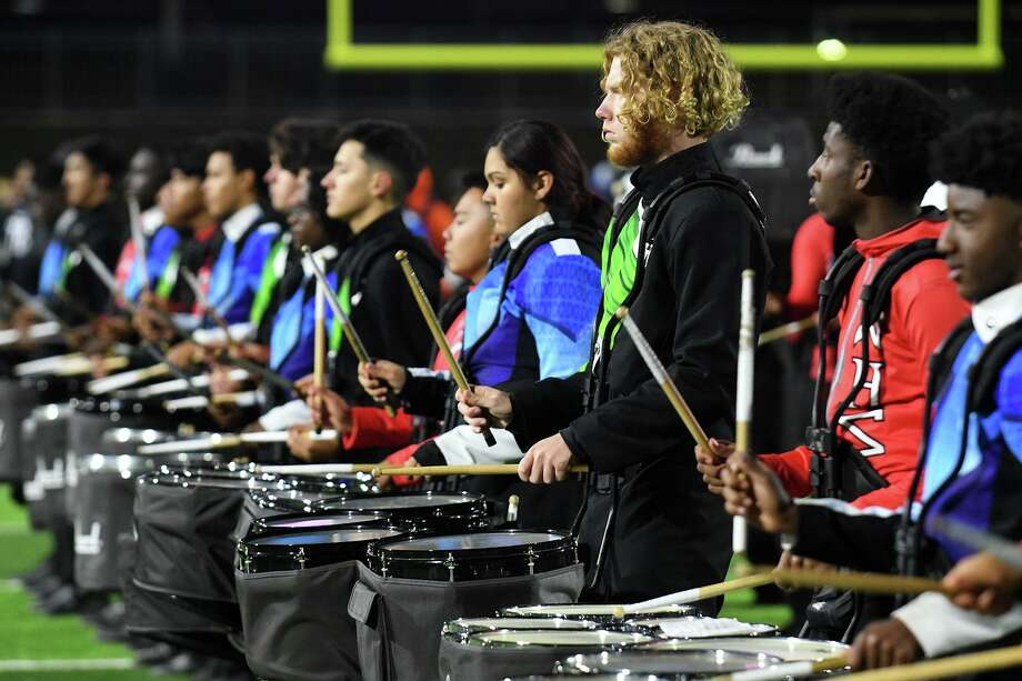 The combined drum lines of Dekaney, Spring and Westfield High Schools perform together during the Planet Ford Stadium open ceremony on Nov. 12, 2019. Photo: Jerry Baker, Houston Chronicle / Contributor / Houston Chronicle