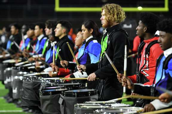 The combined drum lines of Dekaney, Spring and Westfield High Schools perform together during the Planet Ford Stadium open ceremony on Nov. 12, 2019.