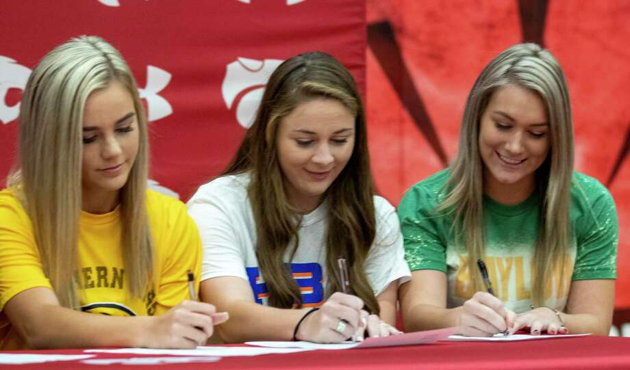 From left, Keeley Wright, Kaicey Hagler and Caleigh Millican sign papers committing to their respective colleges during National Signing Day on Wednesday, November 13, 2019 at Splendora High School. Photo: Cody Bahn, Houston Chronicle / Staff Photographer / © 2019 Houston Chronicle