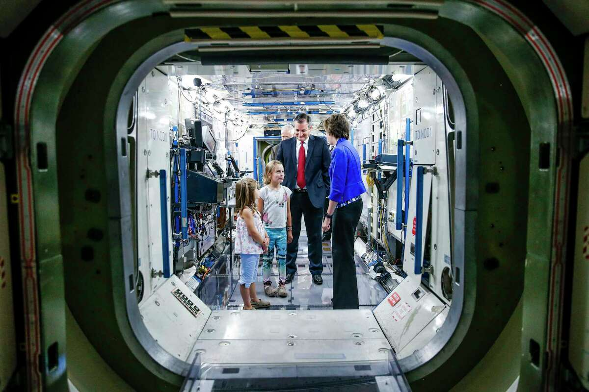 Johnson Space Center Director Dr. Ellen Ochoa gives Sen. Ted Cruz and his daughters, Catherine Cruz, left, and Caroline Cruz, second from left, a tour of a mockup of the International Space Station Monday, August 8, 2016 in Houston. ( Michael Ciaglo / Houston Chronicle )