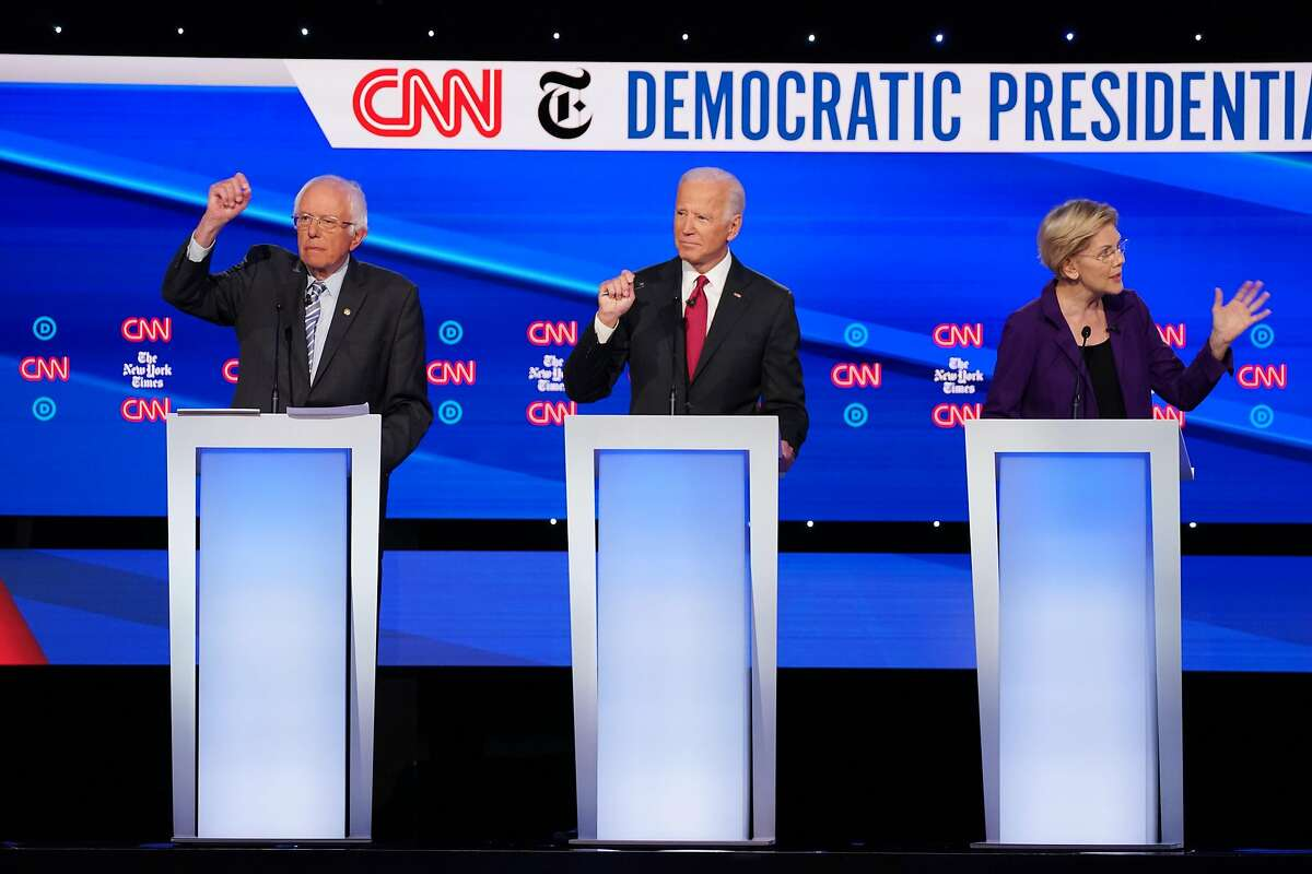 FILE -- Sen. Bernie Sanders (I-Vt.), the former Vice President Joe Biden, and Sen. Elizabeth Warren (D-Mass.) during the Democratic presidential primary debate in Westerville, Ohio, Oct. 15, 2019. Amid intense political debate over proposals from the leading candidates, studies have reached drastically different conclusions about a single-payer system's price tag, cost to families and effect on the health system. (Tamir Kalifa/The New York Times)