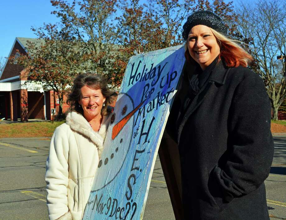 Haddam's Holiday Pop-up Market returns for a second year at Haddam Elementary School, 272 Saybrook Road/Route 154, through Dec. 22. Local artists and friends Janet Verney, left, and Teri Everett, right, have expanded the offerings this year and moved into a much larger space in Higganum Center. Photo: Cassandra Day / Hearst Connecticut Media