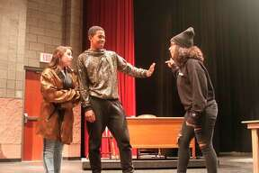 """Manistee/Middle High School Drama students are shown in a scene from the comedy """"Disaster."""" (Ken Grabowski/News Advocate)"""