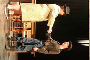 Kyle Wojcik and Kaleb Shoemate who play the two main roles of George Vanderpool and Herbert Field as shown shaking hands in a scene from the play.(Ken Grabowski/News Advocate)
