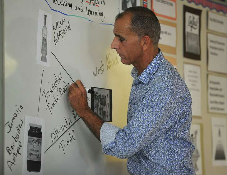 Frank Genova teaches about the slave trade during his African American Studies class at the Bridgeport Military Academy in Bridgeport, Conn. on Thursday, October 4, 2018.