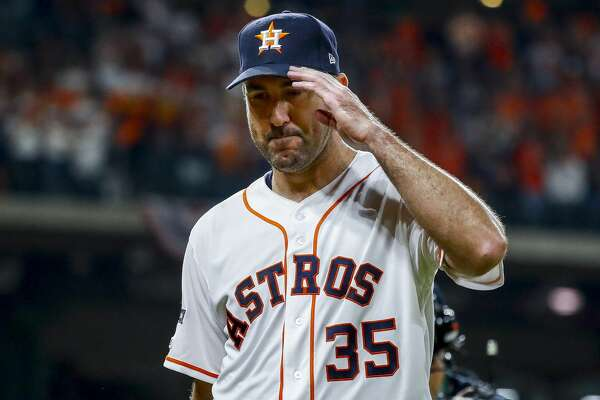 Houston Astros starting pitcher Justin Verlander (35) salutes the crowd as he walks back to the dugout after being taken out of the game during the seventh inning of Game 2 of the American League Championship Series at Minute Maid Park on Sunday, Oct. 13, 2019, in Houston.