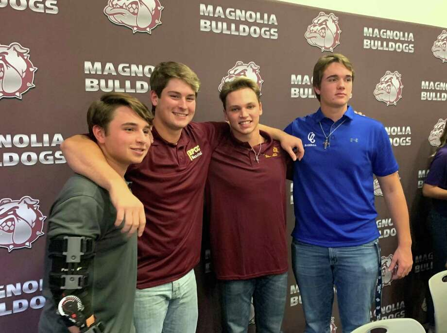 Magnolia baseball players, from left, Joey Raker, Cole Ketzner, Collin Young and Brady Loving celebrated their college signings on Wednesday. Photo: Jon Poorman