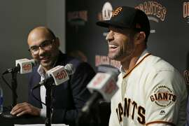 San Francisco Giants manager Gabe Kapler, right, laughs during a news conference as president of baseball operations Farhan Zaidi looks on at Oracle Park Wednesday, Nov. 13, 2019, in San Francisco. Gabe Kapler has been hired as manager of the San Francisco Giants, a month after being fired from the same job by the Philadelphia Phillies. Kapler replaces Bruce Bochy, who retired at the end of the season following 13 years and three championships with San Francisco. (AP Photo/Eric Risberg)
