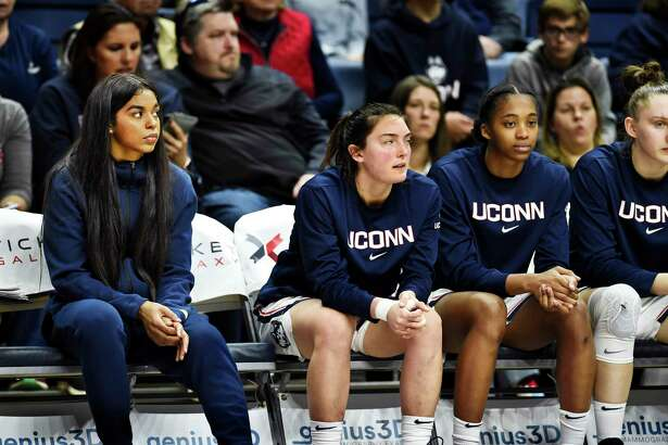 Evina Westbrook, left, sits on the bench during the second half of UConn's game against California Sunday in Storrs. UConn's appeal to the NCAA for a waiver request was denied Wednesday, so Westbrook must sit out this season.