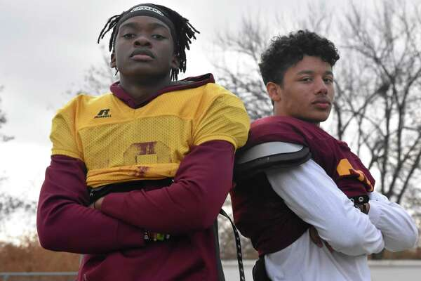 Sheehan's Tre Childers and Jordan Davis stand at Riccitelli Field at Sheehan high, close to 20 months after a serious car crash injured both of them. (Pete Paguaga, Hearst Connecticut Media)