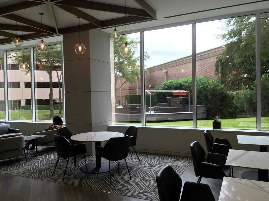 A new seating area for tenants overlooks an outdoor plaza at Sage Plaza. The building at 5151 San Felipe in the Galleria area is managed by CBRE, which worked with architecture firm PDR on the project. Photo: Katherine Feser / Houston Chronicle
