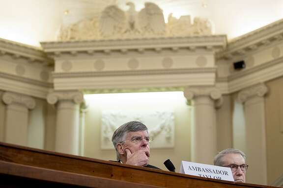 Top U.S. diplomat in Ukraine William Taylor, center, appears before the House Intelligence Committee on Capitol Hill in Washington, Wednesday, Nov. 13, 2019, during the first public impeachment hearing of President Donald Trump's efforts to tie U.S. aid for Ukraine to investigations of his political opponents. (AP Photo/Andrew Harnik)