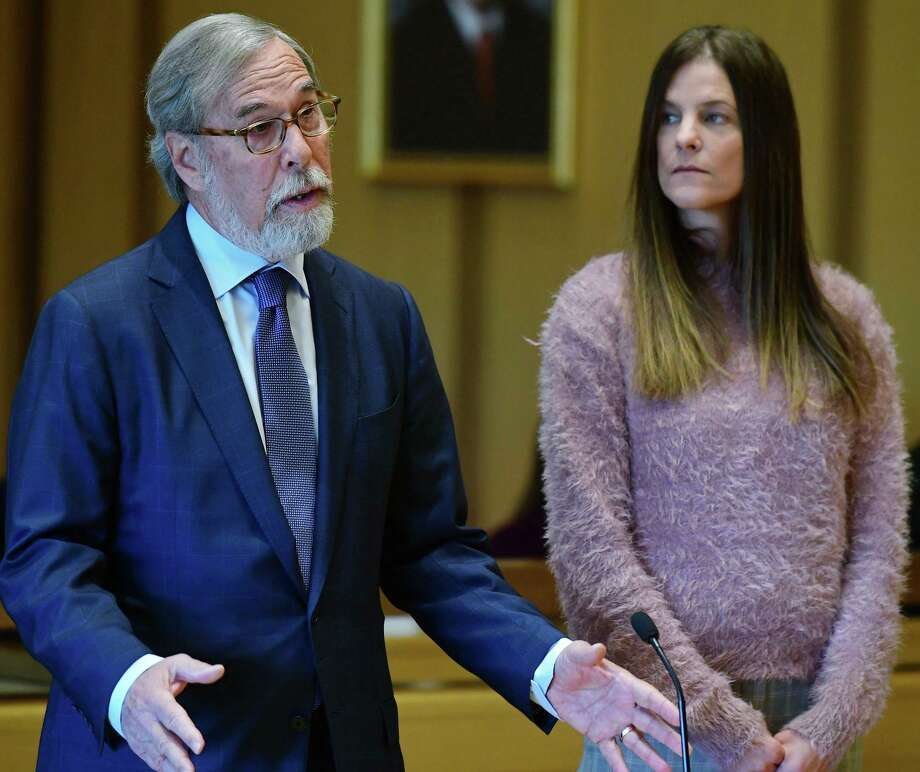 Michelle Troconis, charged with two counts of tampering with evidence and hindering prosecution in the disappearance of Jennifer Dulos, listens to her attorney Andrew Bowman while appearing for a pre-trial hearing Friday, Oct. 25, 2019, at the Stamford Superior Court in Stamford, Conn. Photo: Erik Trautmann / Hearst Connecticut Media / Norwalk Hour