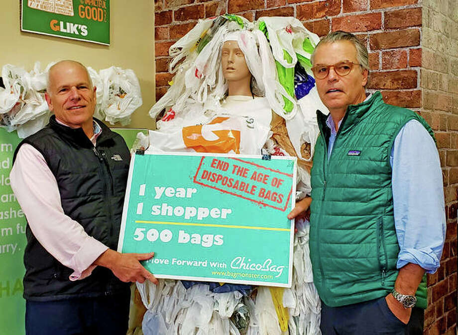 Jeff, left) and Jim Glik stand next to the bag monster sculpture in the recently made selfie room at their Edwardsville location. Photo: Tyler Pletsch | The Intelligencer