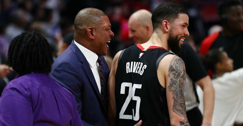 PHOTOS: Rockets game-by-game Doc Rivers of the Los Angeles Clippers speaks to Austin Rivers #25 of the Houston Rockets following their loss at Staples Center on April 03, 2019 in Los Angeles, California. (Photo by Yong Teck Lim/Getty Images) Browse through the photos to see how the Rockets have fared in each game this season. Photo: Yong Teck Lim/Getty Images