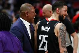 LOS ANGELES, CALIFORNIA - APRIL 03: Doc Rivers of the Los Angeles Clippers speaks to Austin Rivers #25 of the Houston Rockets following their loss at Staples Center on April 03, 2019 in Los Angeles, California. NOTE TO USER: User expressly acknowledges and agrees that, by downloading and or using this photograph, User is consenting to the terms and conditions of the Getty Images License Agreement. (Photo by Yong Teck Lim/Getty Images)