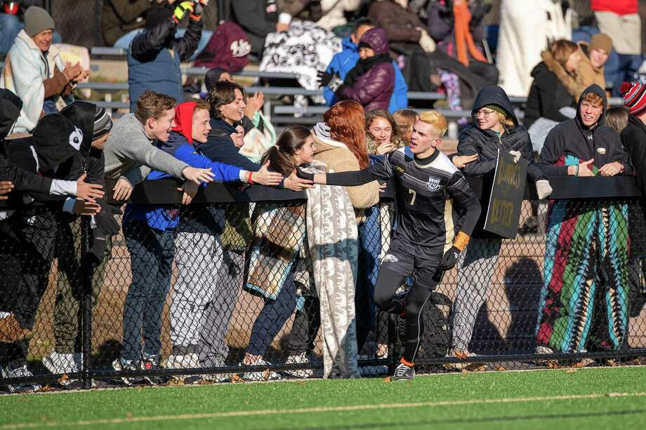 Trumbull High's Matthew Bagley celebrates with the fans after his first goal against Shelton high in the second round of the CIAC CLass LL Boys Soccer State Tournament, Wednesday, November 13, 2019, at Trumbull High School. Photo: David G Whitham / DGWPhotography