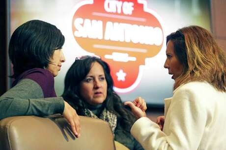 Council members Ana Sandoval, left, and Shirley Gonzales, right discuss items before City Council reviews recommendations for scooter contract finalists Wednesday. Listening is Teresa Menendez Myers, Chief of Staff for Gonzales.
