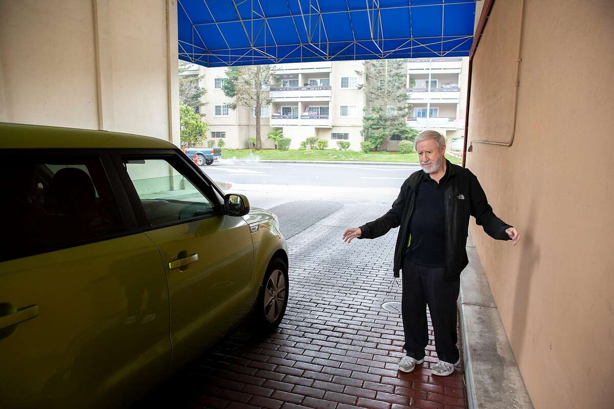 Mike Levinson gets in an Uber on Wednesday, Nov. 13, 2019, in Daly City, Calif. Mike Levinson, who is legally blind, uses a service called GoGoGrandparent which lets him call a toll-free number to summon a rideshare.