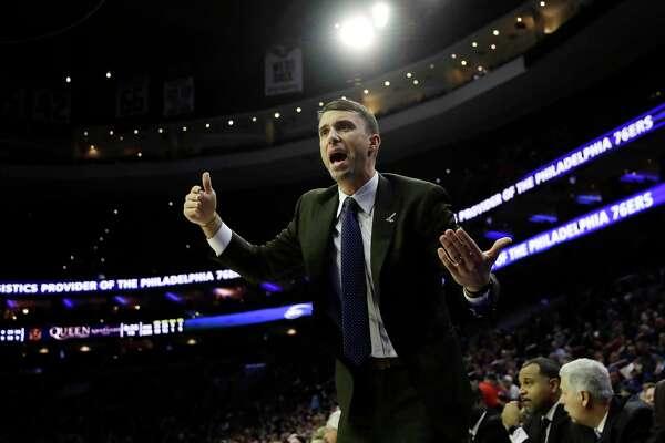 Minnesota Timberwolves interim head coach Ryan Saunders reacts to a call during the second half of an NBA basketball game against the Philadelphia 76ers, Tuesday, Jan. 15, 2019, in Philadelphia. Philadelphia won 149-107. (AP Photo/Matt Slocum)