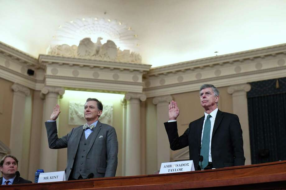 George Kent, left, and William Taylor, right, are sworn in for a House Intelligence Committee impeachment hearing on Nov. 13, 2019 in Washington, DC. Photo: Washington Post Photo By Matt McClain / The Washington Post