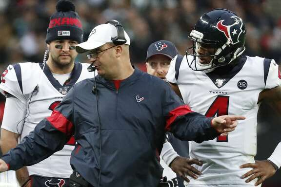 Houston Texans head coach Bill O'Brien talks to quarterback Deshaun Watson (4) during a time out in the third quarter of an NFL football game against the Jacksonville Jaguars at Wembley Stadium on Sunday, Nov. 3, 2019, in London.