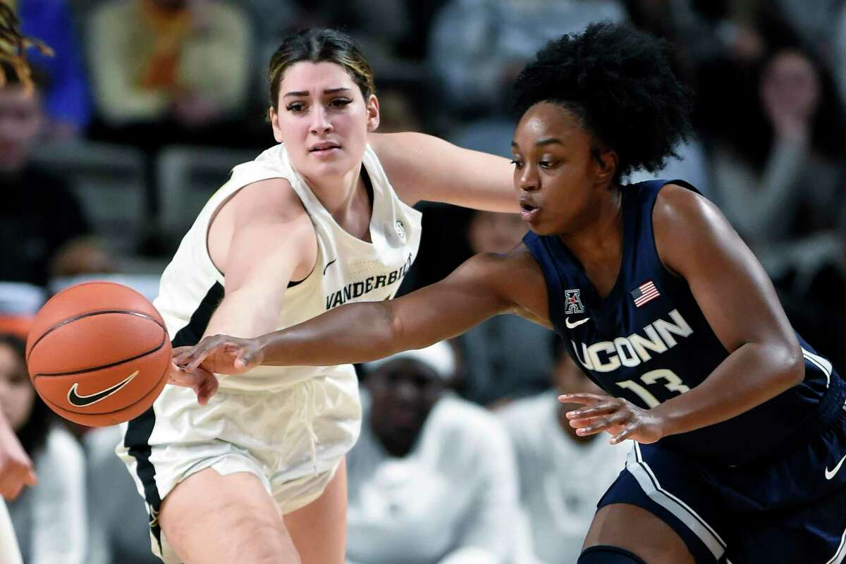 Connecticut guard Christyn Williams (13) reaches for the ball as she is defended by Vanderbilt forward Mariella Fasoula, left, during the second half of an NCAA college basketball game Wednesday, Nov. 13, 2019, in Nashville, Tenn. Connecticut won 64-51. (AP Photo/Mark Zaleski)