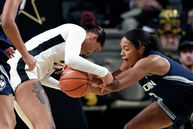 Vanderbilt forward Autumn Newby, left, and UConn forward Megan Walker (3) battle for the ball during the first half of an NCAA college basketball game Wednesday in Nashville.