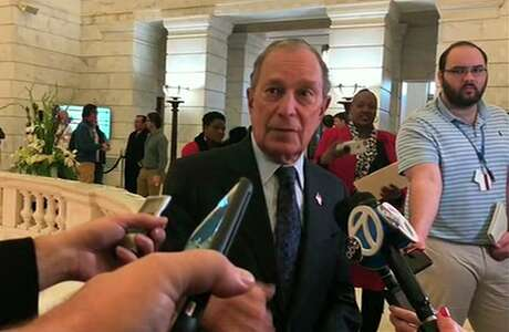 Former New York City Mayor Michael Bloomberg talks to the media after filing paperwork to appear on the ballot in Arkansas' March 3 presidential primary. Bloomberg hasn't formally announced a bid for the Democratic presidential nomination, but his trip to Arkansas on Tuesday is the latest indication that he is leaning toward a run.