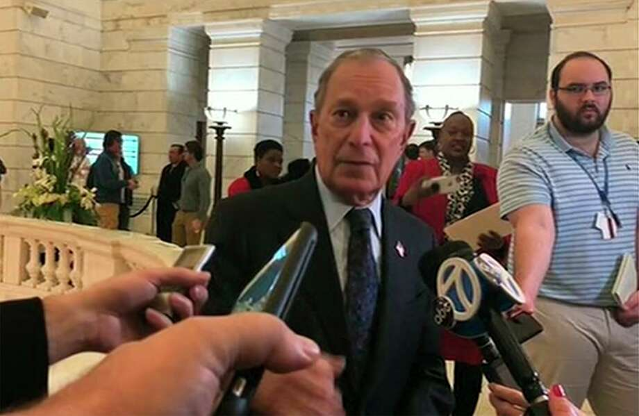 Former New York City Mayor Michael Bloomberg talks to the media after filing paperwork to appear on the ballot in Arkansas' March 3 presidential primary. Bloomberg hasn't formally announced a bid for the Democratic presidential nomination, but his trip to Arkansas on Tuesday is the latest indication that he is leaning toward a run. Photo: Associated Press / AP