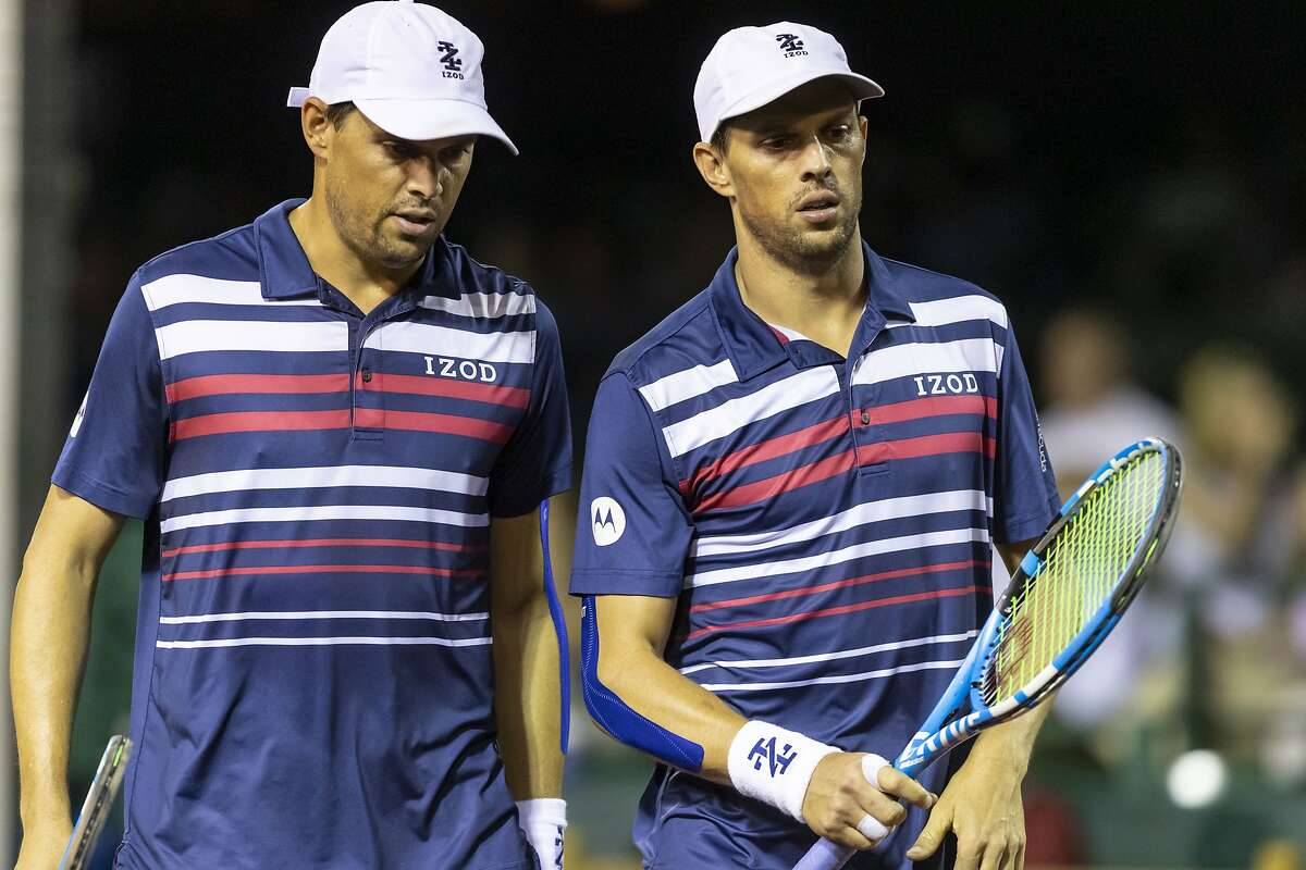 Brothers Bob Bryan and Mike Bryan, of the United States, discuss strategy between serves during the second round of the U.S. Men's Clay Court Championship at River Oaks Country Club on Wednesday, Apr 10, 2019, in Houston.