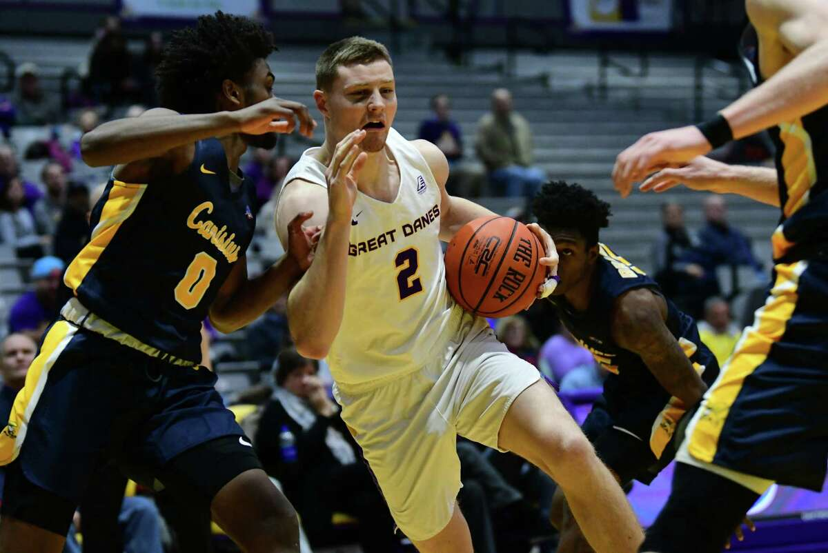University at Albany's Trey Hutcheson drives to the hoop guarded by Canisius' Akrum Ahemed during a basketball game at the SEFCU Arena on Wednesday, Nov. 13, 2019 in Albany, N.Y. (Lori Van Buren/Times Union)