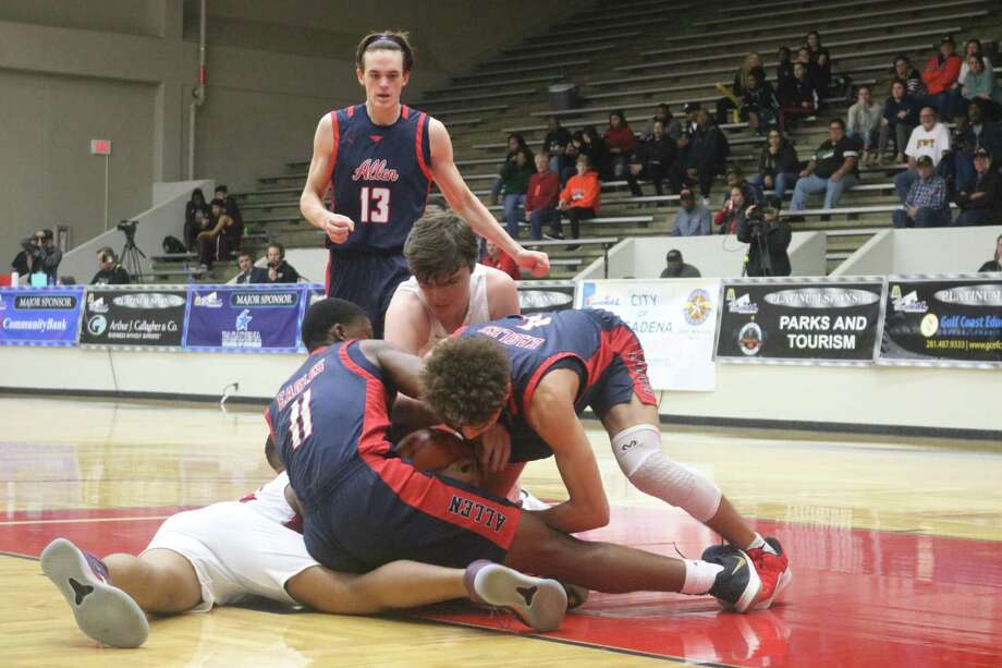 Several Allen High School players dive on the court to make sure a J.J. Pearce player can't escape with a loose ball during last year's Division I Gold championship game. A new basketball bonanza sits just a week away. Photo: Robert Avery