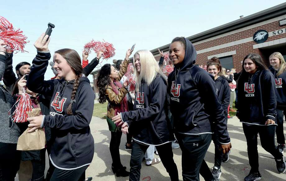 Lamar fans and other sports teams gather to cheer on the Lady Cardinals as they depart Wednesday for their soccer playoff game at UCLA Thursday.