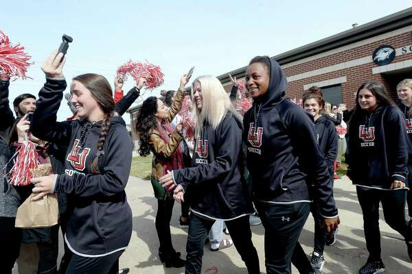 Lamar fans and other sports teams gather to cheer on the Lady Cardinals as they depart Wednesday for their soccer playoff game at UCLA Thursday. Photo taken Wednesday, November 13, 2019 Kim Brent/The Enterprise