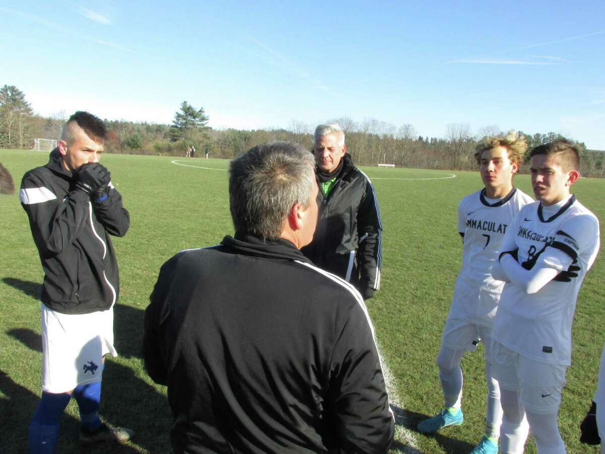 Immaculate players, right, controlled play from the opening coin toss in a Class S boys soccer second-round game win over Litchfield on Wednesday at Litchfield High School.