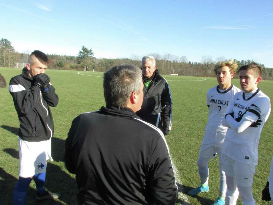 Immaculate players, right, controlled play from the opening coin toss in a Class S boys soccer second-round game win over Litchfield on Wednesday at Litchfield High School. Photo: Peter Wallace / For Hearst Connecticut Media