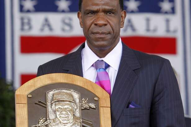 Andre Dawson poses with his plaque after his induction to the Baseball Hall of Fame in Cooperstown, N.Y., on Sunday, July 25, 2010. (AP Photo/Mike Groll)