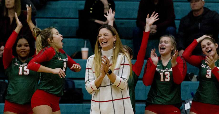 The Woodlands head coach Terri Wade reacts along with the rest of the bench after a play by setter Clara Brower during the second set of a Region II-6A area high school volleyball playoff match at Brenham High School, Thursday, Nov. 7, 2019, in Brenham. Photo: Jason Fochtman/Staff Photographer